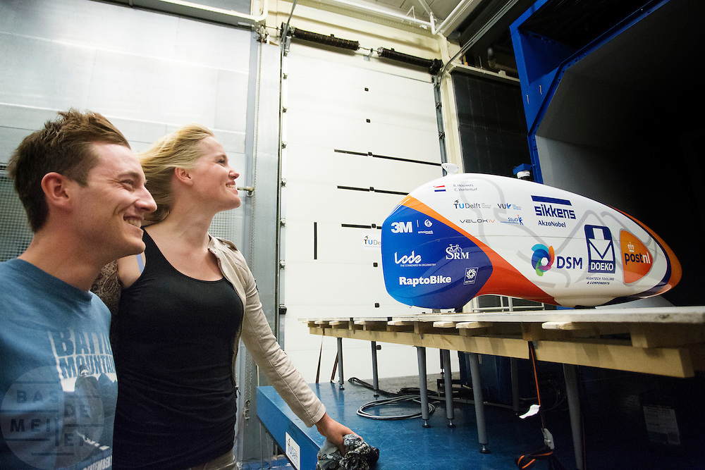 De rijders Christien Veelenturf en Rik Houwers staan in de wind. In Delft test het Human Power Team Delft en Amsterdam (HPT) hun nieuwe fiets, de VeloX4, in de windtunnel. In september wil het HPT, dat bestaat uit studenten van de TU Delft en de VU Amsterdam, een poging doen het wereldrecord snelfietsen te verbreken, dat nu op 133,8 km/h staat tijdens de World Human Powered Speed Challenge.<br /> <br /> Riders Rik Houwers and Christien Veelenturf standing in the wind. The Human Power Team Delft and Amsterdam (HPT) test their new bike, the VeloX4, in the wind tunnel in Delft. With the special recumbent bike the HPT, consisting of students of the TU Delft and the VU Amsterdam, also wants to set a new world record cycling in September at the World Human Powered Speed Challenge. The current speed record is 133,8 km/h.