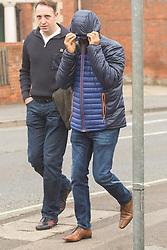 © Licensed to London News Pictures. 28/10/2016. CITY, UK. Mark Compton (R,covered up) arrives at Basingstoke Magistrate's Court today for the trail of Steven Brown, 51, who stands trial accused of stalking his wife Nicola Brown and her friend Mark Compton.  Steven Brown allegedly put a secret GPS device tracker on his wife and Mark's car to prove they were having an affair.  Photo credit : Laura Dale/LNP