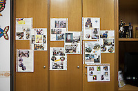 CASERTA, ITALY - 25 FEBRUARY 2015: A visual diary of Casa Rut from 1996, the year of its foundation to 2000, hangs on a living room furniture at Casa Rut, a shelter for abused young immigrant women in Caserta, Italy, on February 25th 2015.<br /> <br /> Casa Rut was founded in 1995 and it is promoted and managed by the Ursuline Sisters of the Sacred Heart of Mary of Breganze (Vicenza, Italy).  Casa Rut's goal is to provide young immigrant women a familiar environment where  they are helped to protect and free themselves, and to undertake a common path aiming to the integration in Italy's society.