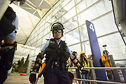 CHINA, Hong Kong: 13 August 2019 <br /> A member of the riot police during clashes with protesters at Hong Kong International Airport on the evening of 13th August 2019. Thousands of demonstrators brought Hong Kong's airport to a standstill for a second day in a row in protest of the extradition bill as well as the police violence and brutality. Demonstrators have taken to the streets of Hong Kong in protest of a controversial extradition bill since 9th of June which has resulted in several violent clashes.<br /> Rick Findler / Story Picture Agency
