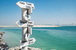 Signposts at The Island Lebanon beach resort on a man made island, part of The World off Dubai coast in  United Arab Emirates