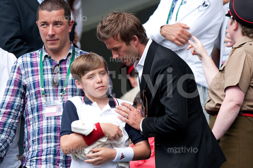 David Beckham and his son Brooklyn Beckham watch the match of Andy Murray (GBR) against Rafael Nadal (ESP) on Centre Court. The Wimbledon Championships 2010 The All England Lawn Tennis & Croquet Club  Day 11 Friday 02/07/2010