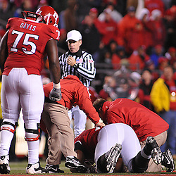 Oct 16, 2009; Piscataway, NJ, USA; Rutgers offensive lineman Anthony Davis (75) watches offensive lineman Kevin Haslam (78) with concern during an injury timeout in the second half of NCAA football action in Pittsburgh's 24-17 victory over Rutgers at Rutgers Stadium.