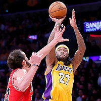 29 January 2015: Los Angeles Lakers center Jordan Hill (27) takes a jump shot over Chicago Bulls center Joakim Noah (13) during the Los Angeles Lakers 123-118 2OT victory over the Chicago Bulls, at the Staples Center, Los Angeles, California, USA.