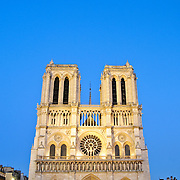 Notre Dame Cathedral, front view, in the evening with a clear blue sky with copy space