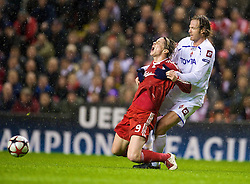 LIVERPOOL, ENGLAND - Wednesday, December 9, 2009: Liverpool's Fernando Torres is brought down by AFC Fiorentina's Per Kroldrup during the UEFA Champions League Group E match at Anfield. (Photo by David Rawcliffe/Propaganda)