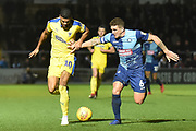 AFC Wimbledon striker (on loan from Luton Town) Jake Jervis (10) battles for possession  with with Wycombe Wanderers defender Adam El-Abd (6) during the EFL Sky Bet League 1 match between Wycombe Wanderers and AFC Wimbledon at Adams Park, High Wycombe, England on 22 December 2018.