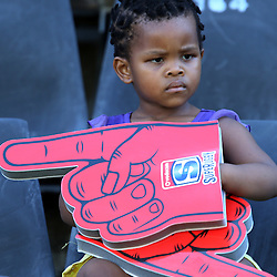 DURBAN, SOUTH AFRICA - MARCH 15: A young fan during the Super Rugby match between Cell C Sharks and Reds at Growthpoint Kings Park on March 15, 2014 in Durban, South Africa. (Photo by Steve Haag/Gallo Images)