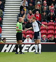 Photo: Andrew Unwin.<br />Middlesbrough v Tottenham Hotspur. The Barclays Premiership. 18/12/2005.<br />Tottenham's Michael Dawson (R) is shown the yellow card by the referee, Howard Webb (L).
