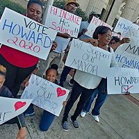 Supporters of Mayor Maurice Howard gather before last week's board of aldermen meeting to show their support for his salary to be reinstated. There was no action taken on the matter.