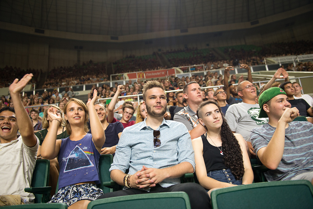 First year students react to President McDavis duiring the First Year Student Convocation. Photo by Ben Siegel