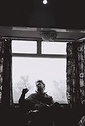 Man smoking, Southall, UK, 1985