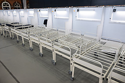 © Licensed to London News Pictures. 11/04/2020. Manchester, UK. Beds are placed on a ward . The National Health Service is building a 648 bed field hospital for the treatment of Covid-19 patients , at the historical railway station terminus which now forms the main hall of the Manchester Central Convention Centre . The facility is due to open on Easter Monday , 13th April 2020 , and will treat patients from across the North West of England , providing them with general medical care and oxygen therapy after discharge from Intensive Care Units . Photo credit: Joel Goodman/LNP
