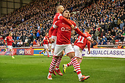 Jacob Brown of Barnsley FC celebrating his team's first goal during the EFL Sky Bet Championship match between Barnsley and Huddersfield Town at Oakwell, Barnsley, England on 11 January 2020.