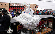 NEDERLAND, CO - MARCH 10: Traci Hunnewell, 2018 Ice Queen for Frozen Dead Guy Days, rides on a hearse in the parade at the event on March 10, 2018 in Nederland, Colorado. The Frozen Dead Guy Days festival is in honor of Bredo Morstol, who is frozen on dry ice and housed in a shed above the town. (Photo by Rick T. Wilking/Getty Images)