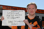 Picture by David Horn/Focus Images Ltd +44 7545 970036.20/04/2013.A Barnet fan holds up a Good Luck banner before Barnet's last game at Underhill Stadium before the npower League 2 match at Underhill Stadium, London.