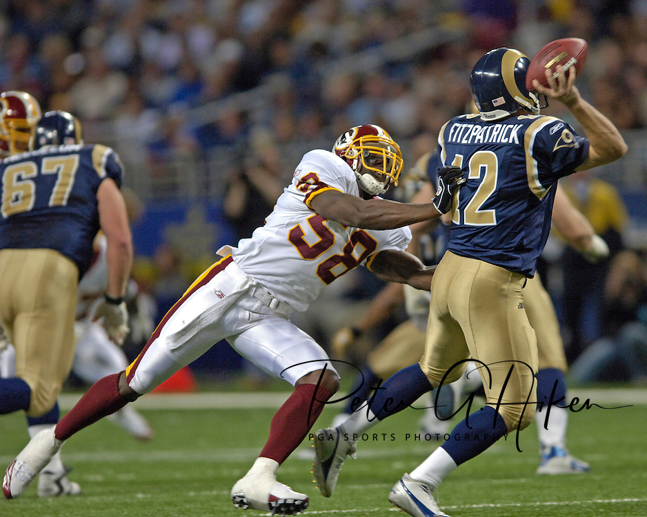 Washington Redskins linebacker Chris Clemons (L) pressures St. Louis Rams quarterback Ryan Fitzpatrick (R) in the second quarter, during the Redskins 24-9 win at the Edward Jones Dome in St. Louis, Missouri, December 4, 2005.
