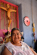 "South Tucson resident of 20 years, Juanita Figueroa, 77, proudly states, ""It's mine"", about her home ownership in the southside community, Tucson, Arizona, USA."