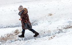 THEMENBILD - eine Frau mit Handtasche spaziert auf der schneebedeckten Strasse, aufgenommen am 13. Jaenner 2017, Kaprun, Österreich // A woman with handbag walking on the snow covered road in Kaprun, Austria on 2017/01/13. EXPA Pictures © 2017, PhotoCredit: EXPA/ JFK