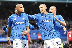 Kevin-Prince Boateng (L-Portsmouth) celebrates scoring a penalty with Hassan Yebda (C) and Jamie O'Hara (R). Portsmouth v Manchester United (1-4), Barclays Premier League Fratton Park, Portsmouth, 28th November 2009.