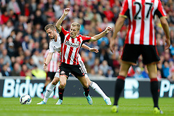 Sebastian Larsson of Sunderland is tackled by Gylfi Sigurosson of Swansea City - Photo mandatory by-line: Rogan Thomson/JMP - 07966 386802 - 27/08/2014 - SPORT - FOOTBALL - Sunderland, England - Stadium of Light - Sunderland v Swansea City - Barclays Premier League.