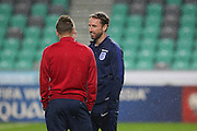 England Manager Gareth Southgate (caretaker) talks to England Forward Jamie Vardy during a general stadium walk around before the Slovenia vs England FIFA World Cup Group F Qualifier match at Stadion Stozce, Ljubljana, Slovenia on 10 October 2016. Photo by Phil Duncan.
