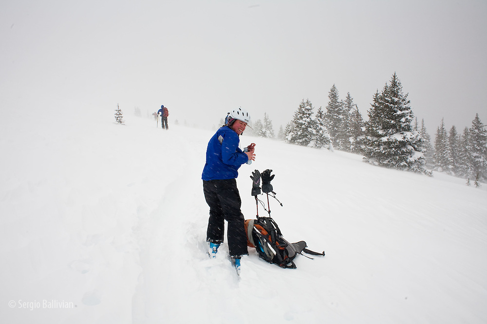A group of skiers tour in the backcountry during a winter storm in Colorado.  All skiers need to be prepared for avalanche and harsh weather conditions while backcountry skiing in Colorado.