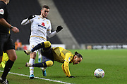 Milton Keynes Dons midfielder Brennan Dickenson (11) fouls Coventry City midfielder Jodi Jones (7) during the EFL Trophy match between Milton Keynes Dons and Coventry City at Stadium:MK, Milton Keynes, England on 3 December 2019.