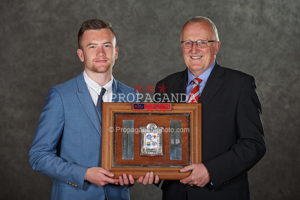 NEWPORT, WALES - Saturday, May 30, 2015: Wales' Scott Coughlan with Cledwyn Ashford and the Victory Shield at the Celtic Manor Resort. (Pic by David Rawcliffe/Propaganda)