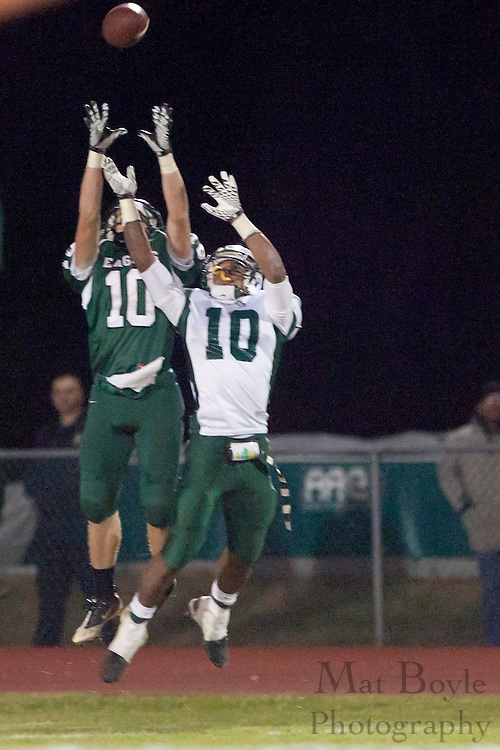 West Deptford High School's Alex Hilbmann (10) and Pemberton High School's Nate Brown (10) go up for a pass during a Group 2 first round playoff game at West Deptford High School on Friday November 11, 2011. (photo / Mat Boyle)