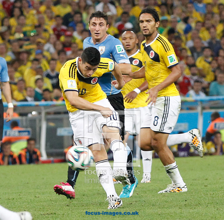 James Rodriguez of Colombia  scores their first goal during the 2014 FIFA World Cup last 16 match at Maracana Stadium, Rio de Janeiro, Brazil.<br /> Picture by Andrew Tobin/Focus Images Ltd +44 7710 761829<br /> 28/06/2014
