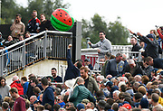 Fans in the temporary stand playing with a giant inflatable melon during the International Test Match 2019, fourth test, day two match between England and Australia at Old Trafford, Manchester, England on 5 September 2019.