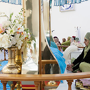 Slough, Greater London, UK, January 24, 2015. <br /> Although the preference for men among British Indians is still prevalent, one now finds a number of women fulfilling the function of priest in the Indian Sikh community. Here, in the Ramgharia Sikh Gurdwara Temple.