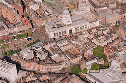 Aerial view of Nottingham looking north over city centre with Council House and the Market Square in the centre of the picture,  St Peters Church is towards the bottom of the picture; surrounded by trees,
