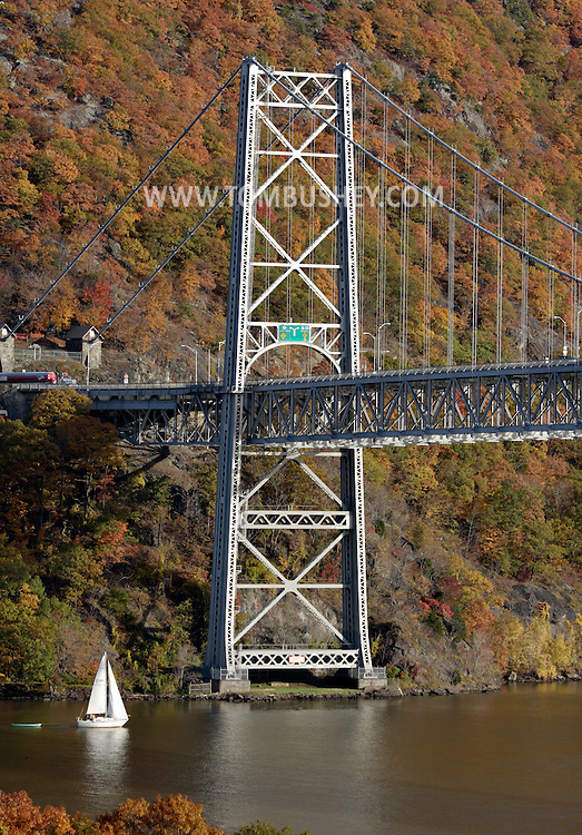 Fort Montgomery, NY - A sailboat heads south on the Hudson River by the Bear Mountain Bridge on Nov. 2, 2008.