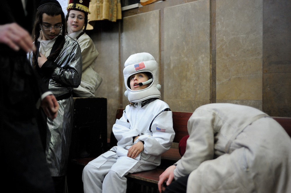 JERUSALEM, ISRAEL - MARCH 17, 2014: An Ultra-Orthodox Jewish kid, wearing an astronaut costume, celebrate the Purim holiday in the ultra-orthodox Mea Shearim neighborhood in Jerusalem on March 17, 2014. The festival of Purim commemorates the rescue of Jews from a genocide in ancient Persia. Photo by Gili Yaari