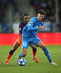 Manchester City's Raheem Sterling (left) and Hoffenheim's Florian Grillitsch battle for the ball