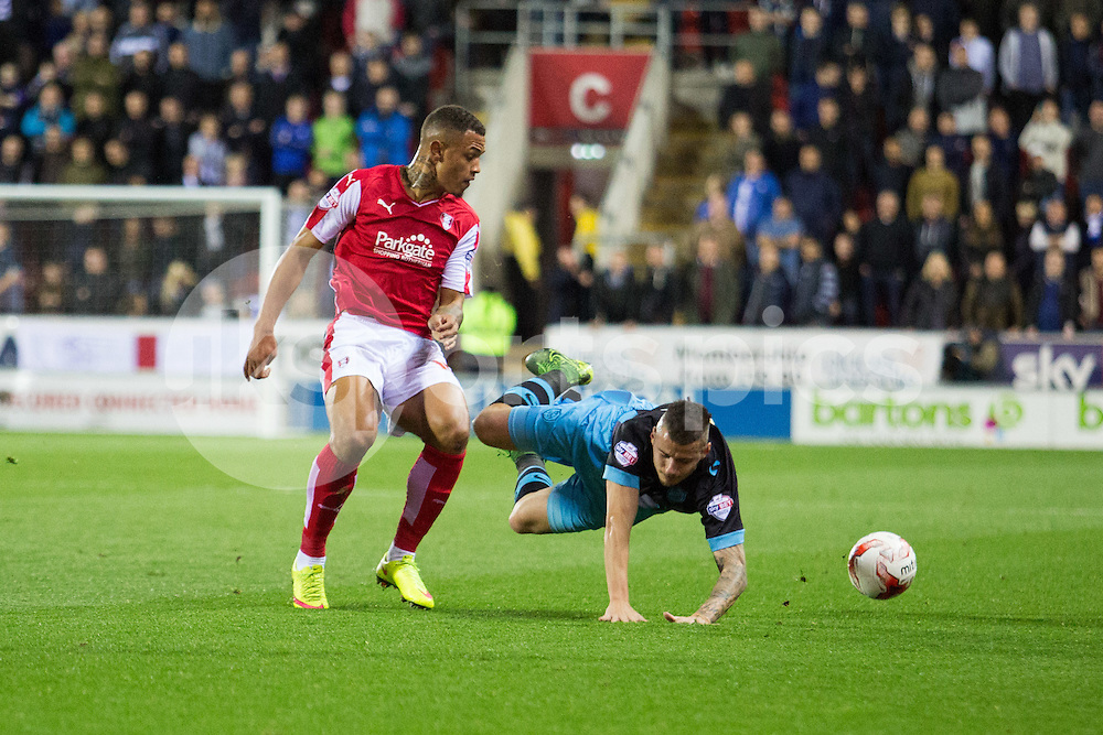 Jonson Clarke-Harris of Rotherham United brings down Daniel Pudil of Sheffield Wednesday during the Sky Bet Championship match between Rotherham United and Sheffield Wednesday at the Aesseal New York Stadium, Rotherham, England on 23 October 2015. Photo by James Williamson.