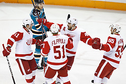 November 30, 2010; San Jose, CA, USA; Detroit Red Wings right wing Daniel Cleary (11) is congratulated by center Valtteri Filppula (51) and center Henrik Zetterberg (40) and defenseman Niklas Kronwall (55) after scoring a goal against the San Jose Sharks during the first period at HP Pavilion. Mandatory Credit: Jason O. Watson / US PRESSWIRE