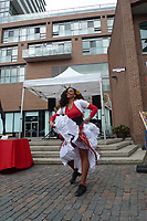 Cuban guitarist and dancers perform ayt The Victoria Day market, The Distillery District, Toronto , Ontario, Canada