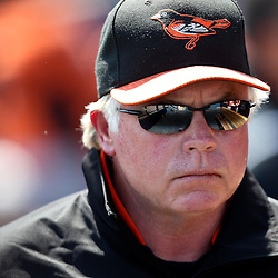 March 20, 2011; Port Charlotte, FL, USA; Baltimore Orioles manager Buck Showalter (26) during a spring training exhibition game against the Tampa Bay Rays at Charlotte Sports Park.   Mandatory Credit: Derick E. Hingle