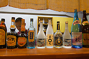 Miyako-jima. Sangoya restaurant. Sake bottles.