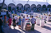 People buying vegetables from traders at traditional market, Lanzarote, Canary Islands, Spain, 1979