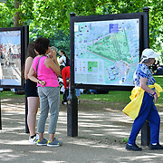 London, UK. 27 June 2019. UK Weather - The Hottest week in June 2019 . Tourists looking at a map at St James  Park, London, UK