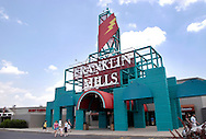 PHILADELPHIA, PA - JUNE 15:  Shoppers walk near one of the entrances to Franklin Mills Mall June 15, 2005 in Philadelphia, Pennsylvania. (Photo by William Thomas Cain)
