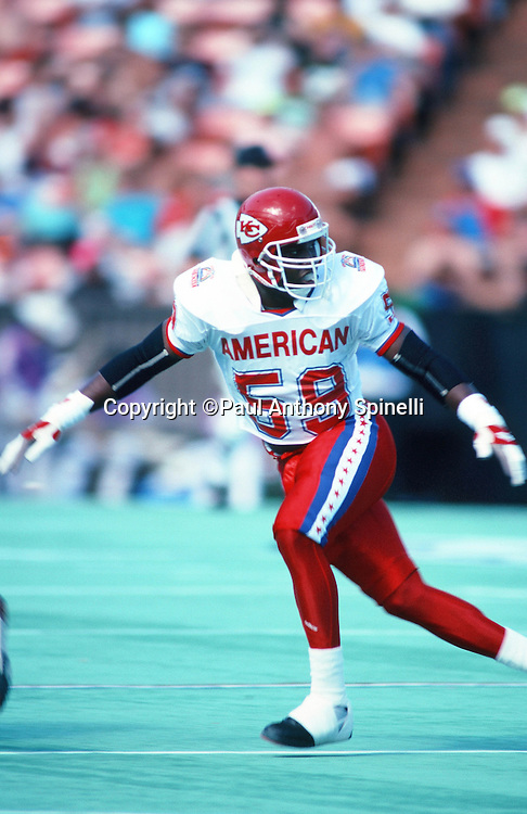 Kansas City Chiefs linebacker Derrick Thomas (59) blocks during the 1990 NFL Pro Bowl between the National Football Conference and the American Football Conference on Feb. 4, 1990 in Honolulu. The NFC won the game 27-21. (©Paul Anthony Spinelli)