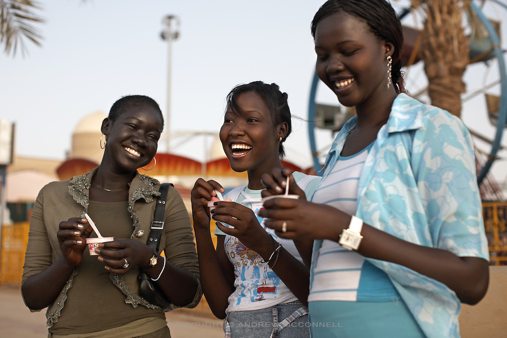 Teenagers enjoy ice cream outside the Afra mall in Khartoum, Sudan, on Monday. Khartoum's first mall 'Afra' opened in 2004 and has become a place to congregate for young Sudanese..Khartoum is modeling itself as the Dubai of Africa and despite Western sanctions the city is booming. Away from the troubles and poverty that plaque the rest of Sudan, development in Khartoum is moving at an astonishing rate. Investment from the East, and in particular China, allowed the Sudanese economy to grow by 11% in 2007. This growth is driven largely by oil, with production rising from 63,000 barrels per day in 1999 to over 500,000 barrels today.