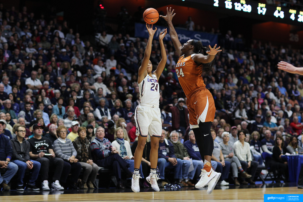 UNCASVILLE, CONNECTICUT- DECEMBER 4: Napheesa Collier #24 of the Connecticut Huskies shoots for three defended by Joyner Holmes #24 of the Texas Longhorns during the UConn Huskies Vs Texas Longhorns, NCAA Women's Basketball game in the Jimmy V Classic on December 4th, 2016 at the Mohegan Sun Arena, Uncasville, Connecticut. (Photo by Tim Clayton/Corbis via Getty Images)