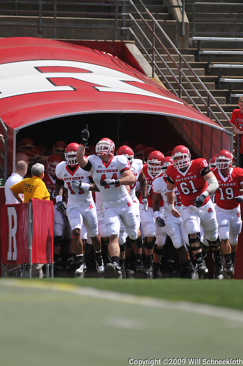 Apr 18, 2009; Piscataway, NJ, USA; Rutgers LB Ryan D'Imperio (44) and C Ryan Blaszczyk (61) lead the team onto the field as inter-squad captains prior to Rutgers' Scarlet and White spring football scrimmage.