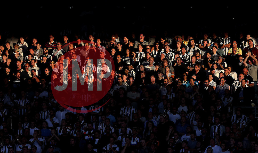 A shaft of sunlight hits some of the Newcastle United as they watch their side play against Fulham in the opening fixture of the Sky Bet Championship season - Mandatory by-line: Robbie Stephenson/JMP - 05/08/2016 - FOOTBALL - Craven Cottage - Fulham, England - Fulham v Newcastle United - Sky Bet Championship